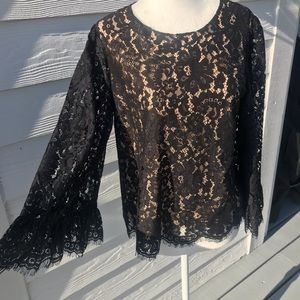 Chico's lace blouse with tan lining.